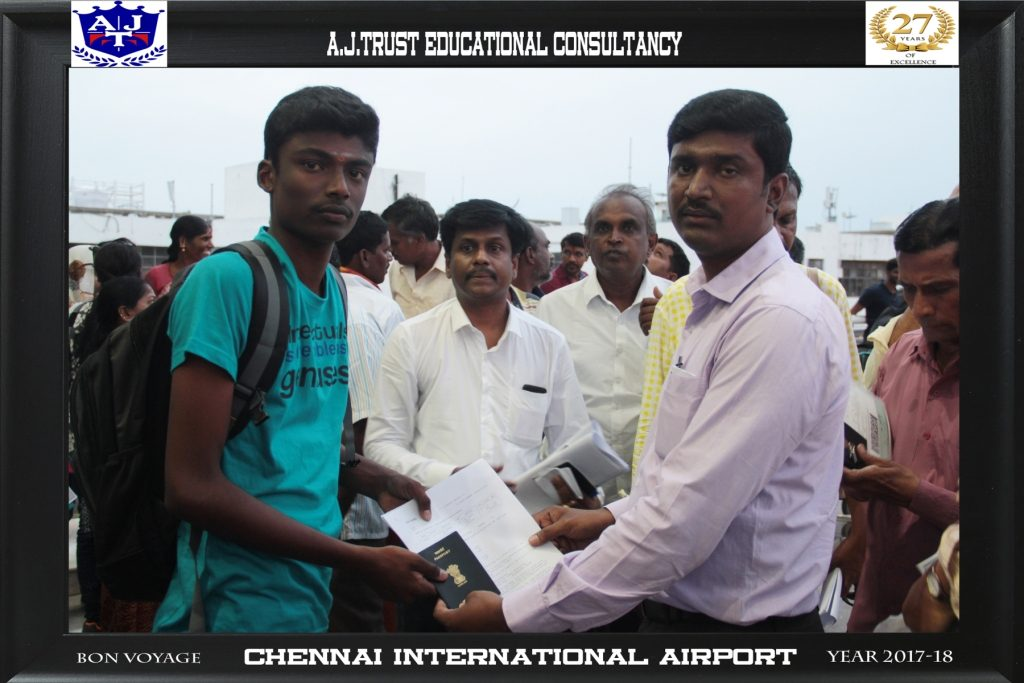 DR.FAHADH  HANDING OVER TRAVEL DOCUMENTS TO THE STUDENT AT AIRPORT